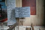 Lessons on a chalkboard in a church in Gabon