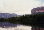 Tabletop mountains (called tepui) as seen from the Rio Carrao