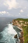 Breaking waves below cliffs of Uluwatu (Jimbaran, Bali)