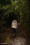 Staff member at Pondok Tanggui leading walk to orangutan feeding platform (Kalimantan, Borneo (Indonesian Borneo))