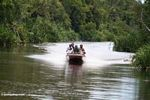Silica miners in a speedboat heading upriver to an illegal mining zone (Kalimantan, Borneo (Indonesian Borneo))