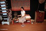 Woman spinning silk in Rantepao (Toraja Land (Torajaland), Sulawesi)