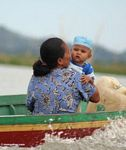 Woman with baby in traditional Buginese motorized boat (Sulawesi (Celebes))