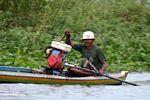 Man driving traditional Buginese motorized canoe (Sulawesi (Celebes))