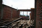 Hotel under construction with bamboo poles (Sulawesi (Celebes))