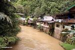 Riverside homes downriver from the Bantimurung waterfalls (Sulawesi (Celebes))