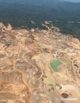 Mining trucks, equipment, opne pits and roads at the Rio Huaypetue gold mine in southeastern Peru