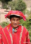 Willoq man wearing traditional red clothing