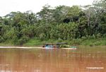 River boat carrying goods to market on the Rio Tambopata