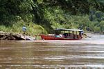 Motorized canoe filled ith cargo on the Rio Tambopata in Peru